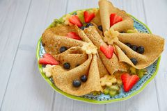 Funny butterfly shaped crepes with berries Stock Photos
