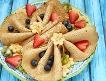 Funny butterfly shaped crepes with berries Royalty Free Stock Photos