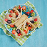 Funny butterfly shaped crepes with berries Royalty Free Stock Image