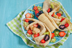 Funny butterfly shaped crepes with berries Stock Images