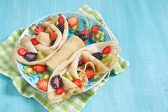 Funny butterfly shaped crepes with berries Royalty Free Stock Photography