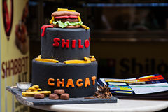 Funny cake in jewish cafe in Ghetto quarter in Rome. Funny cake with cheesburger a top in jewish cafe in Ghetto quarter in Rome, Italy Royalty Free Stock Photos