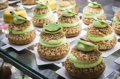 Frog faced cakes on a display royalty free stock photo