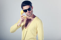 Funny call center guy with hipster glasses Royalty Free Stock Photos