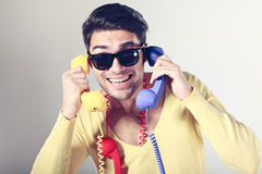 Funny call center men with colorful phones Royalty Free Stock Images