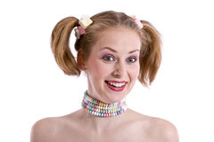 Funny candy girl. Pretty young blond girl with candy around her neck and in her hair Royalty Free Stock Images