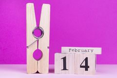 Funny card to the day of lovers. Large clothespin and wooden calendar. Valentines day concept royalty free stock image