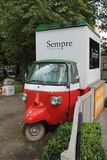 Funny cargo van with one front wheel stock photos