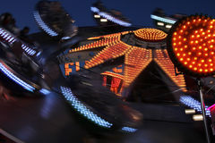 Funny carousel. Bright colored and fast motion carousel at night Stock Photo