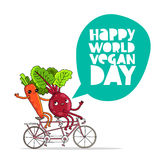 Funny carrots and beets on a bicycle Stock Photo