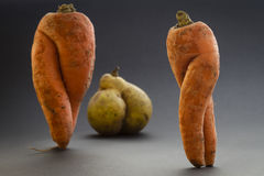 Funny carrots and pear, diet concept Royalty Free Stock Image
