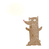 Funny cartoon bear with thought bubble Stock Image