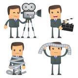 Funny cartoon businessman and cinema Stock Photos