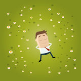 Funny cartoon businessman lies in grass stock illustration
