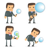 Funny cartoon businessman with magnifying glass Royalty Free Stock Images