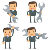 Funny cartoon businessman with a spanner. Set of funny cartoon businessman in various poses for use in presentations, etc Royalty Free Stock Photography