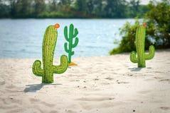 Funny cartoon cactuses in desert. Decotation Royalty Free Stock Photos
