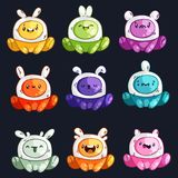 Funny cartoon colorful glossy aliens set. Little monsters collection. Stock Photography