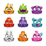 Funny cartoon colorful glossy aliens set. Stock Images