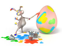 Funny cartoon Easter bunny  as artist painting on a egg. Cartoon Easter Bunny as abstract artist is painting on a egg on white background. Holiday  3d Royalty Free Stock Photos
