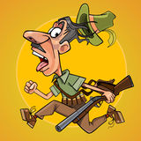Funny cartoon hunter with gun runs away in fright Royalty Free Stock Image