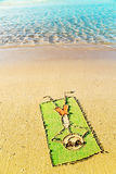 Funny cartoon laying on a towel on the beach Royalty Free Stock Photo