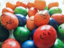 Funny cartoon like faces drawn on Easter Eggs. Our family spin off the Romanian tradition of colored Easter Eggs: after boiling and coloring the eggs, all of us Stock Images