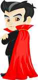Funny cartoon little vampire, boy wearing Halloween costume Stock Photos