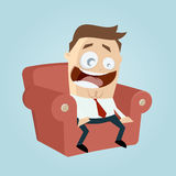 Funny cartoon man on couch is excited Royalty Free Stock Image