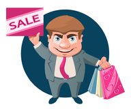 Funny cartoon man holds a sale sign and shopping bags. Royalty Free Stock Images
