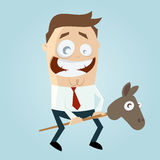 Funny cartoon man with toy horse stock image