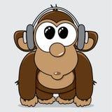 Funny cartoon monkey with headphones Stock Photos