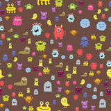 Funny cartoon monster seamless pattern alien character creature happy illustration devil colorful animal background. Funny cartoon monster seamless pattern cute Stock Photography