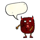 Funny cartoon monster with speech bubble Royalty Free Stock Images