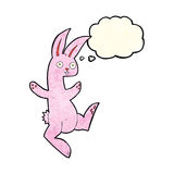 Funny cartoon pink rabbit with thought bubble Stock Photos