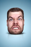 Funny cartoon portrait. From man`s face on color background Stock Photo
