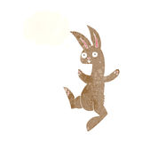 Funny cartoon rabbit with thought bubble Stock Photography