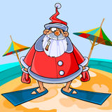 Funny cartoon Santa Claus wearing flippers on the beach Stock Images