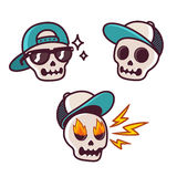 Funny cartoon skull set. Set of funny cartoon skull character in baseball cap. Cool skull with sunglasses, angry with flame in eyes. Sticker collection Stock Photography