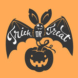 Funny cartoon smiling bat with spread wings and Trick or Treat lettering carrying carved Halloween pumpkin against. Orange background. Vector illustration for Royalty Free Stock Image