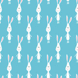 Funny cartoon white rabbits. Seamless pattern background. Stock Photography