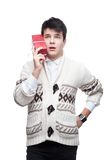 Funny casual winter man holding christmas gift Royalty Free Stock Photos