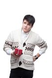 Funny casual winter man holding christmas gift Royalty Free Stock Photo