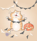 Funny cat making paper garland for halloween Royalty Free Stock Photography