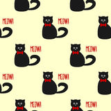 Funny cat with round eyes and a bow. Text Meow! Seamless pattern. Stock Images