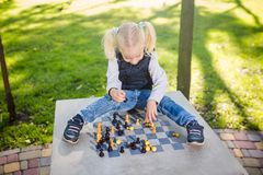 Funny Caucasian baby girl blonde does not want learn, does not want to school, want to play, laugh and indulge. child with hair royalty free stock images