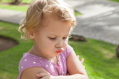 Funny Caucasian blond baby girl resentfully pouts Royalty Free Stock Photos