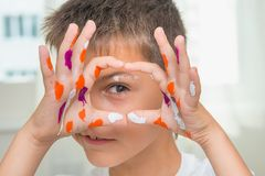 Funny caucasian boy with painted hands, joyful artist, selective. Focus. Education and creativity theme royalty free stock photo