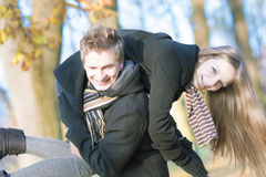Funny caucasian young couple making piggyback together Royalty Free Stock Photo