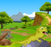 Funny chameleon cartoon in the jungle with landscape background Stock Photography